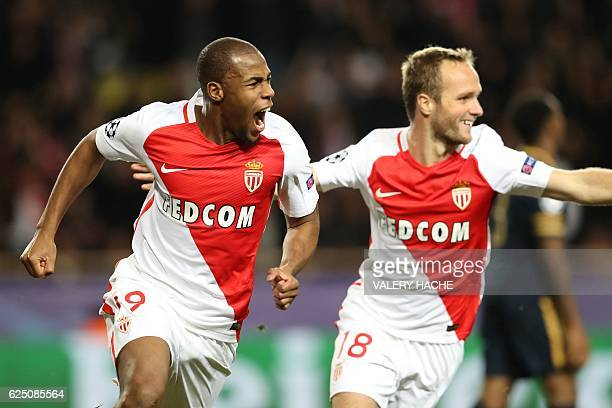 Monaco's French defender Djibril Sidibe celebrates with Monaco's French forward Valere Germain after scoring their first goal during the UEFA...