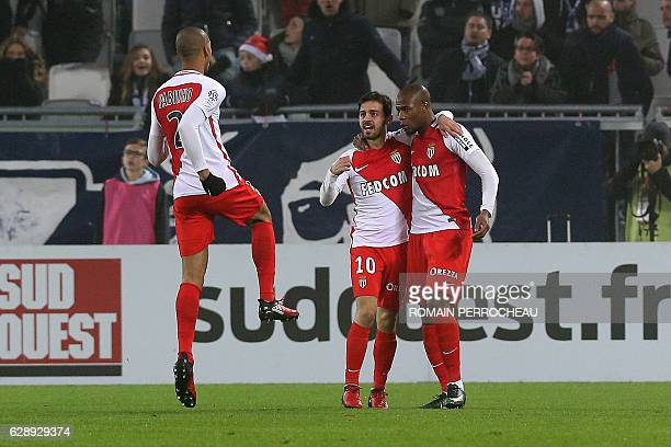 Monaco's French defender Djibril Sidibe is congratulated by Monaco's Portuguese midfielder Bernardo Silva after scoring a goal during the French L1...