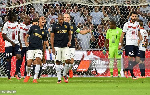 Monaco's French defender Djibril Sidibe is congratuled by his team mates after scoring a goal during the French L1 football match between Lille OSC...