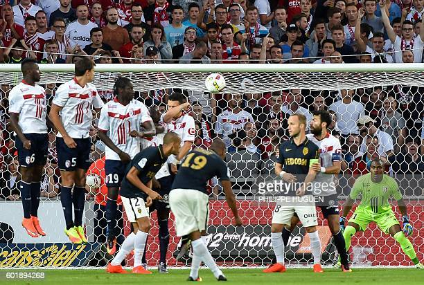 Monaco's French defender Djibril Sidibe kicks the ball to score a goal during the French L1 football match between Lille OSC and AS Monaco FC at the...