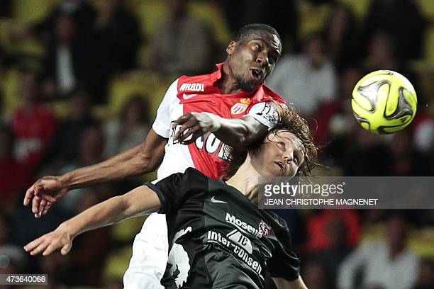 Monaco's French defender Geoffrey Kondogbia vies with Metz' midfielder Janis Ikaunieks during the French L1 football match Monaco vs Metz on May 16...