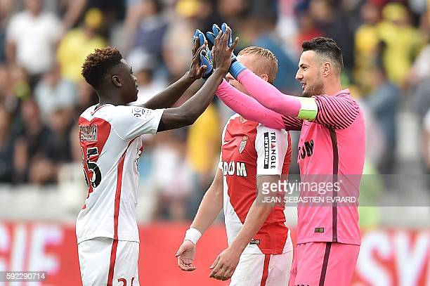 Monaco's French defender Kevin Ndoram and Monaco's Croatian goalkeeper Danijel Subasic gesture at the end of the French L1 football match between FC...