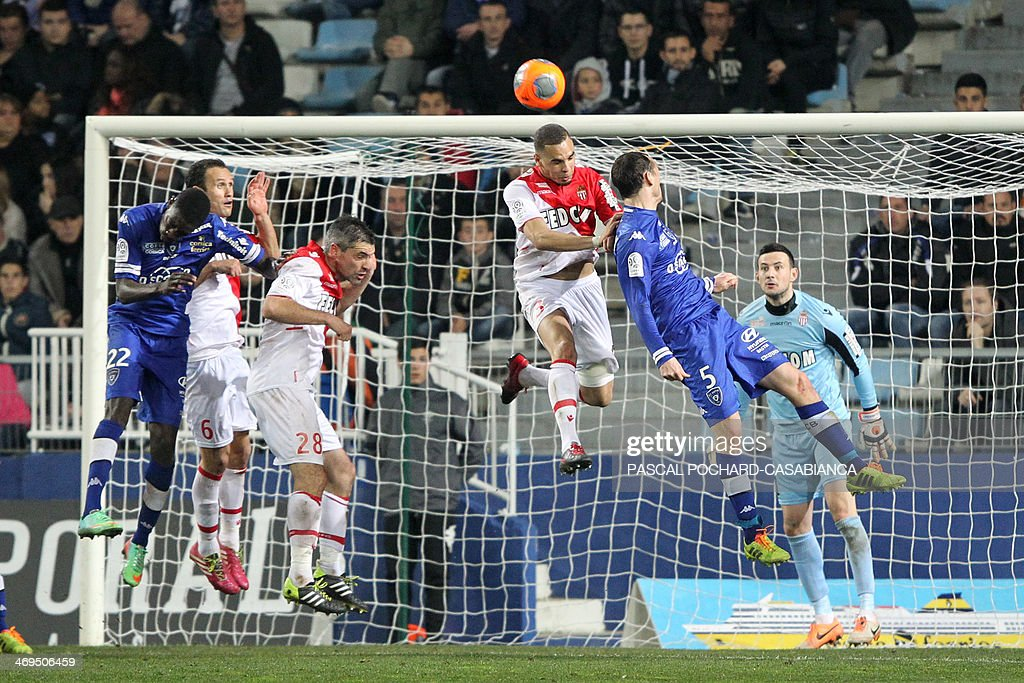 Monaco's French defender Layvin Kurzawa (C) and Bastia's French defender Sebastien Squillaci (2nd R) vie for the ball during the French L1 football match Bastia (SCB) against Monaco in the Armand Cesari stadium in Bastia, Corsica, on February 15 , 2014. Monaco defeated Bastia 2-0.
