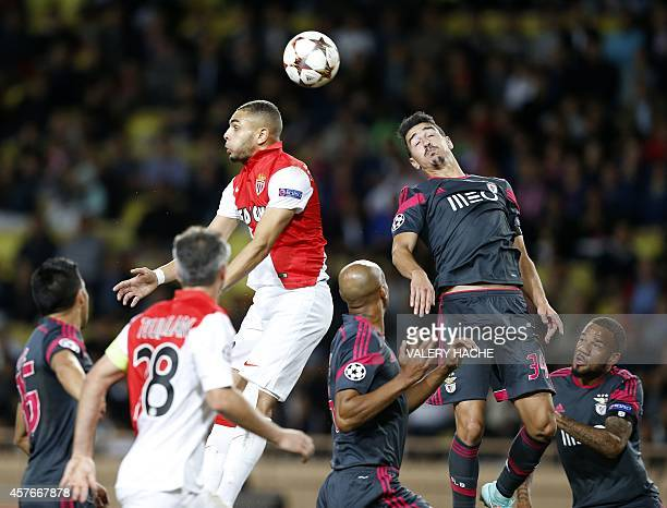 Monaco's French defender Layvin Kurzawa and Benfica's defender Andre Almeida vie for the ball during the UEFA Champions League Group C football match...