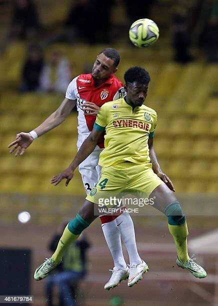 Monaco's French defender Layvin Kurzawa and Nantes' French midfielder GeorgesKevin N'Koudou go for a header during the French L1 football match...