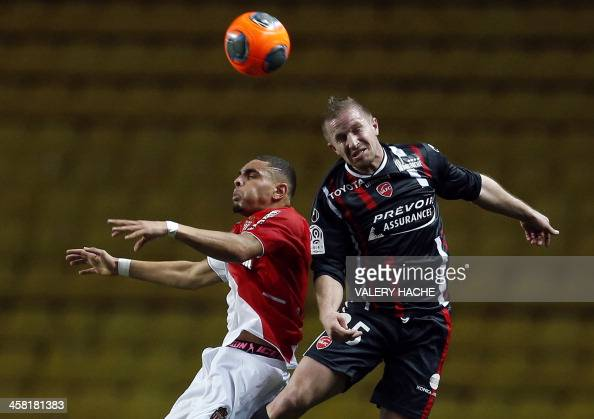 Monaco's French defender Layvin Kurzawa heads the ball with Valenciennes' French defender Rudy Mater during the French L1 football match between...