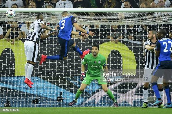 Monaco's French defender Layvin Kurzawa tries to score against Juventus' goalkeeper and captain Gianluigi Buffon and Juventus' midfielder from Chile...