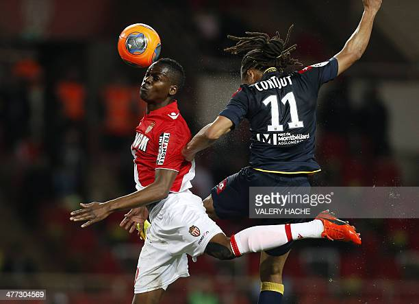 Monaco's French defender Nicolas Isimat Mirin heads the ball with Sochaux's French forward Roy Contout during the French L1 football match between AS...