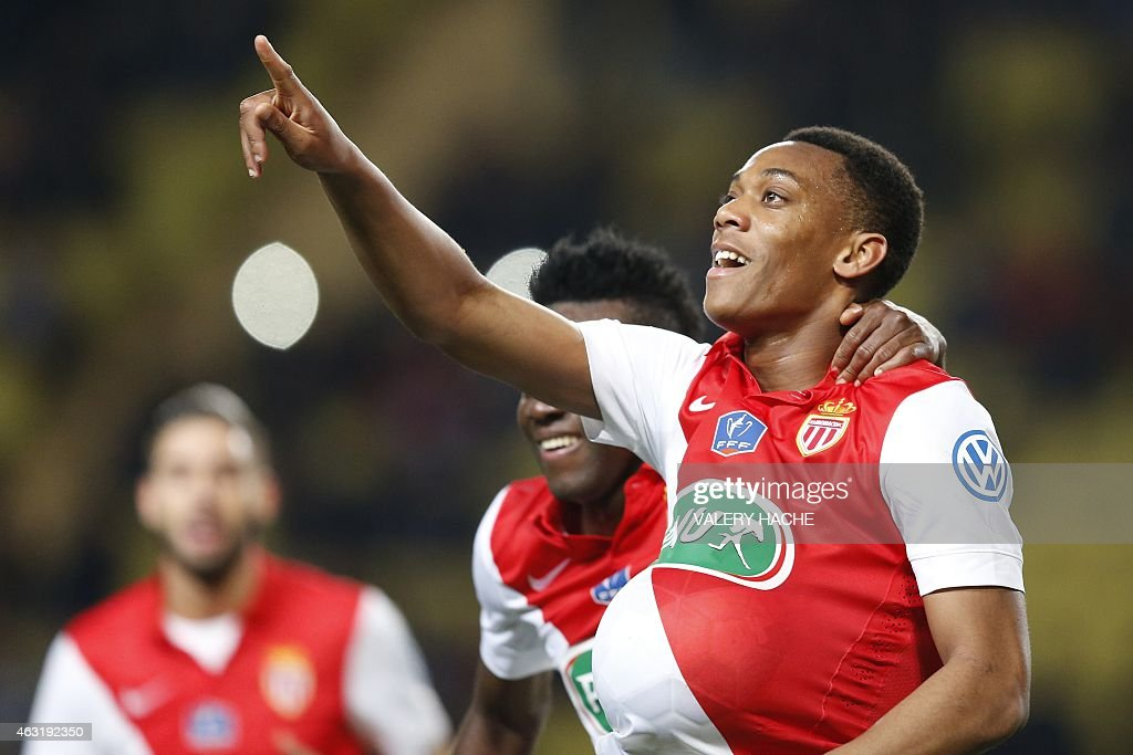 Monaco's French forward <a gi-track='captionPersonalityLinkClicked' href=/galleries/search?phrase=Anthony+Martial&family=editorial&specificpeople=9197434 ng-click='$event.stopPropagation()'>Anthony Martial</a> (R) celebrates after scoring a goal with teammate midfielder <a gi-track='captionPersonalityLinkClicked' href=/galleries/search?phrase=Alain+Traore&family=editorial&specificpeople=4146262 ng-click='$event.stopPropagation()'>Alain Traore</a> of Burkina Faso during the French Cup football match Monaco (ASM) vs Rennes (SRFC) at Louis II stadium in Monaco on February 11, 2015.