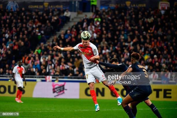 Monaco's French forward Irvin Cardona heads the ball next to Paris SaintGermain's Italian midfielder Thiago Motta and Paris SaintGermain's French...