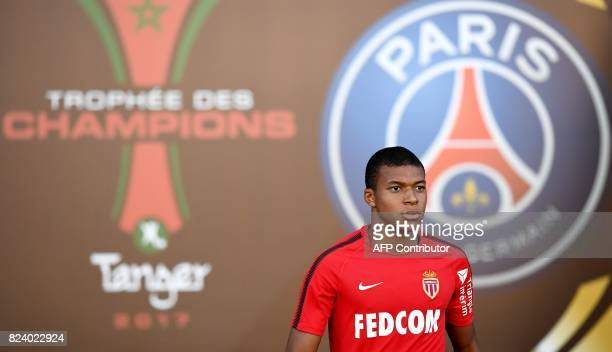 Monaco's French forward Kylian Mbappe arrives for a training session at the Grand Stade in Tangiers on July 28 2017 on the eve of the French Trophy...