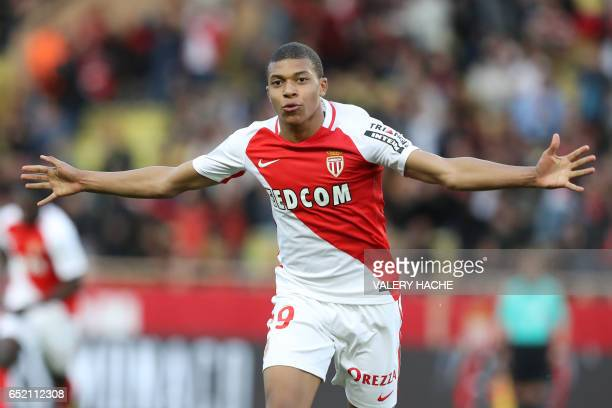 Monaco's French forward Kylian Mbappe celebrates after scoring a goal during the French L1 football match Monaco vs Bordeaux on March 11 2017 at the...