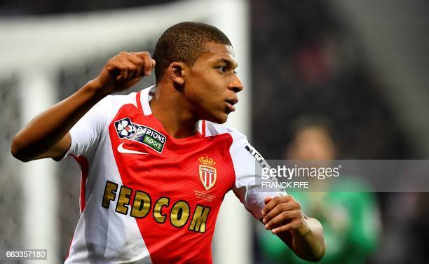 Monaco's French forward Kylian Mbappe gestures during the French League Cup final football match between Paris SaintGermain and Monaco on April 1 at...