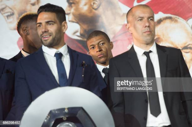 Monaco's French forward Kylian Mbappe looks on next to Monaco's Colombian forward Radamel Falcao and Monaco's Portuguese coach Leonardo Jardim as...