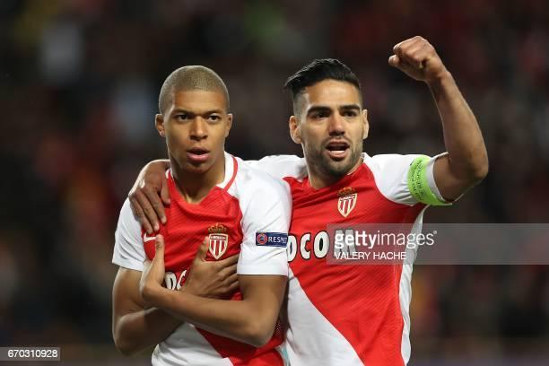 Monaco's French forward Kylian Mbappe Lottin and Monaco's Colombian forward Radamel Falcao celebrate after Mbappe opened the scoring during the UEFA...