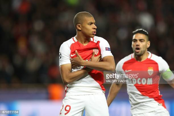 Monaco's French forward Kylian Mbappe Lottin and Monaco's Colombian forward Radamel Falcao celebrate after Mbappe opened the scoring during the UEFA...