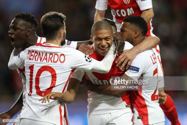 Monaco's French forward Kylian Mbappe Lottin and teammates celebrate after Mbappe opened the scoring during the UEFA Champions League 2nd leg...