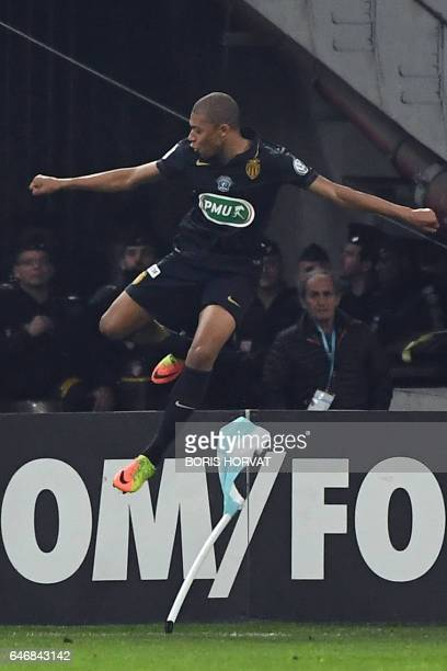 Monaco's French forward Kylian Mbappe Lottin celebrates after scoring a goal during the French Cup football match between Marseille and Monaco on...