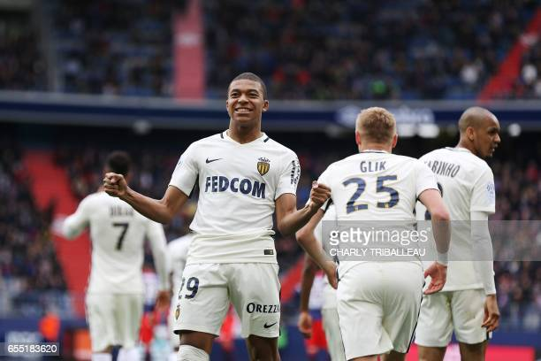 Monaco's French forward Kylian Mbappe Lottin celebrates after scoring a goal during the French L1 football match between Caen and Monaco on March 19...