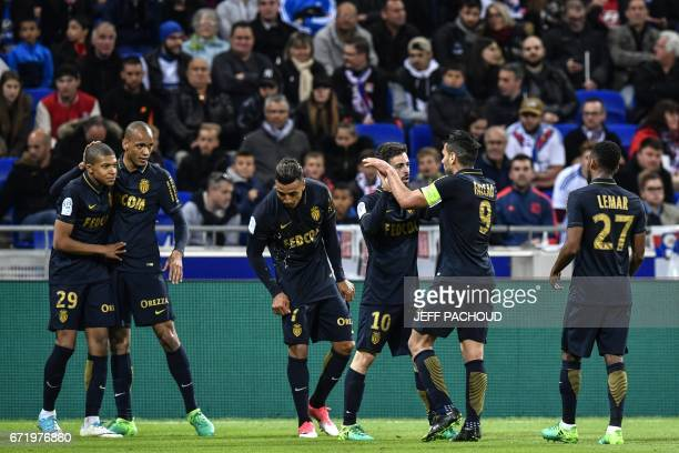 Monaco's French forward Kylian Mbappe Lottin celebrates with his teamates after scoring a goal during the French L1 football match Olympique Lyonnais...