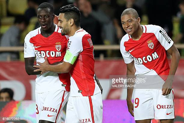Monaco's French forward Kylian Mbappe Lottin celebrates with Monaco's Colombian forward Radamel Falcao and Monaco's French defender Benjamin Mendy...