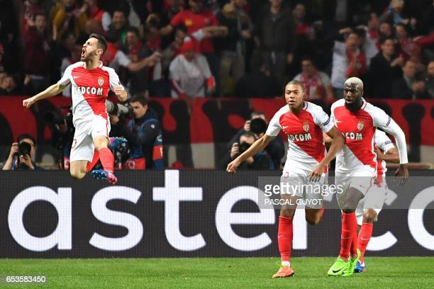 Monaco's French forward Kylian Mbappe Lottin celebrates with Monaco's Portuguese midfielder Bernardo Silva and Monaco's French midfielder Tiemoue...