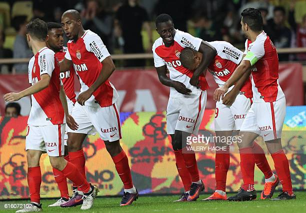 Monaco's French forward Kylian Mbappe Lottin celebrates with teammates after scoring a goal during the French L1 football match between AS Monaco and...