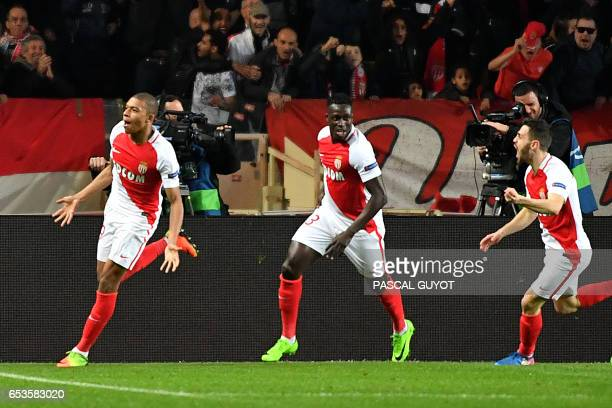 Monaco's French forward Kylian Mbappe Lottin celebrates with teammates after scoring a goal during the UEFA Champions League round of 16 football...