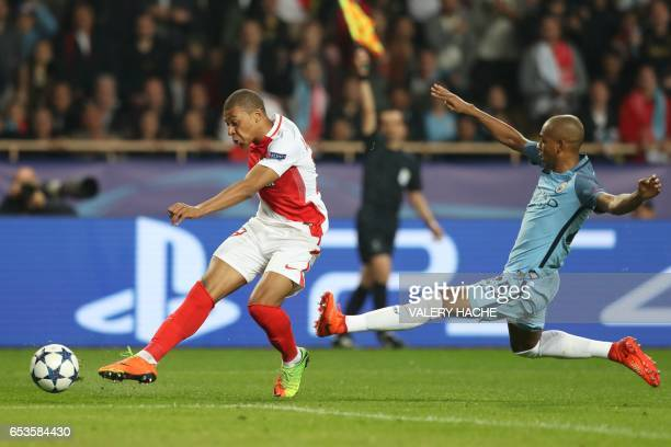 Monaco's French forward Kylian Mbappe Lottin challenges Manchester City's Brazilian midfielder Fernandinho during the UEFA Champions League round of...