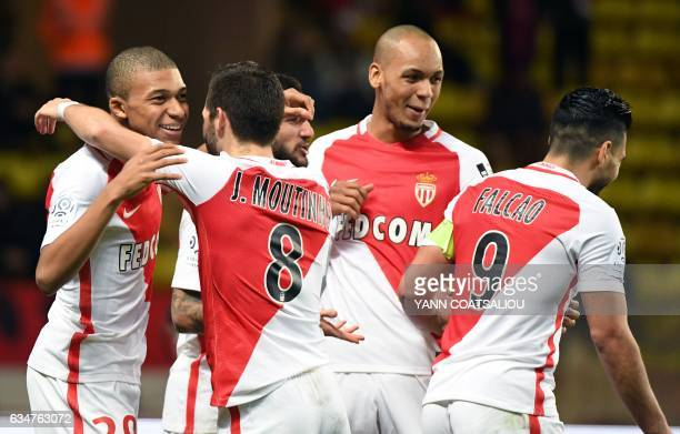 Monaco's French forward Kylian Mbappe Lottin is congratulated by teammates after scoring a goal during the French Ligue 1 football match between AS...