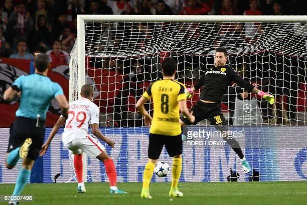 Monaco's French forward Kylian Mbappe Lottin opens the scoring during the UEFA Champions League 2nd leg quarterfinal football match AS Monaco v BVB...