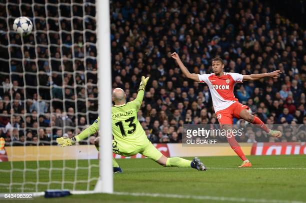 TOPSHOT Monaco's French forward Kylian Mbappe Lottin scores their second goal during the UEFA Champions League Round of 16 firstleg football match...