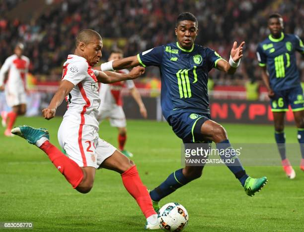 Monaco's French forward Kylian Mbappe Lottin vies with Lille's French defender Franck Beria during the French L1 football match between Monaco and...
