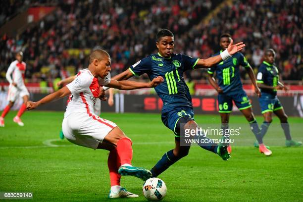 Monaco's French forward Kylian Mbappe Lottin vies with Lille's French defender Franck Beria during the French L1 football match between AS Monaco and...