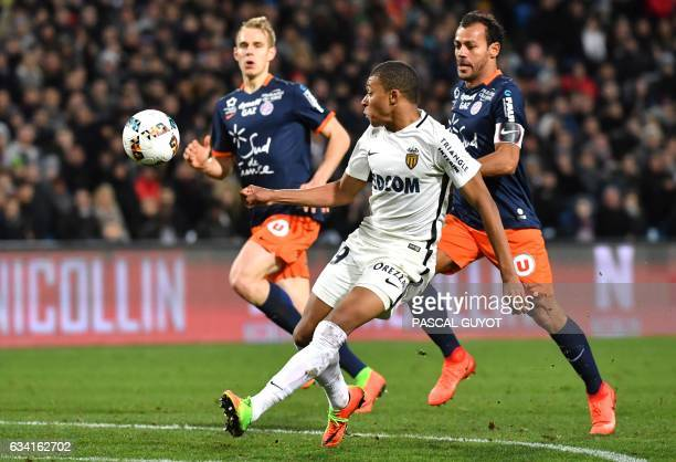 Monaco's French forward Kylian Mbappe Lottin vies with Montpellier's Brazilian defender Victorio Hilton and Montpellier's Czech defender Lukas...