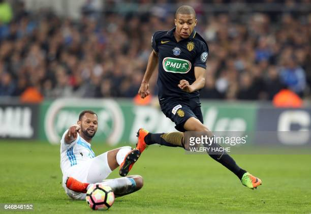 Monaco's French forward Kylian Mbappe Lottin vies with Olympique de Marseille's Portuguese defender Rolando Jorge Pires da Fonseca during the French...