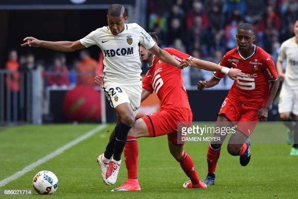 Monaco's French forward Kylian Mbappe Lottin vies with Rennes' Algerian defender Ramy Bensebaini during the French L1 football match between Rennes...
