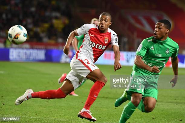 Monaco's French forward Kylian Mbappe Lottin vies with SaintEtienne's French defender PierreYves Polomat during the French L1 football match Monaco...