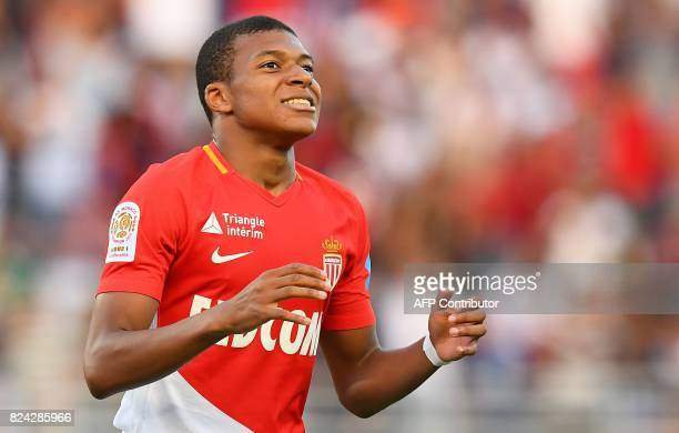 Monaco's French forward Kylian Mbappe reacts after missing a goal opportunity during the French Trophy of Champions football match between Monaco and...