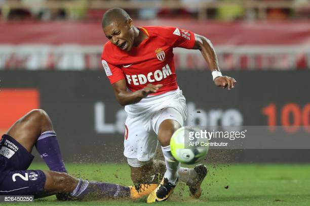 TOPSHOT Monaco's French forward Kylian Mbappe reacts as he falls during the French L1 football match between Monaco and Toulouse at Louis II Stadium...