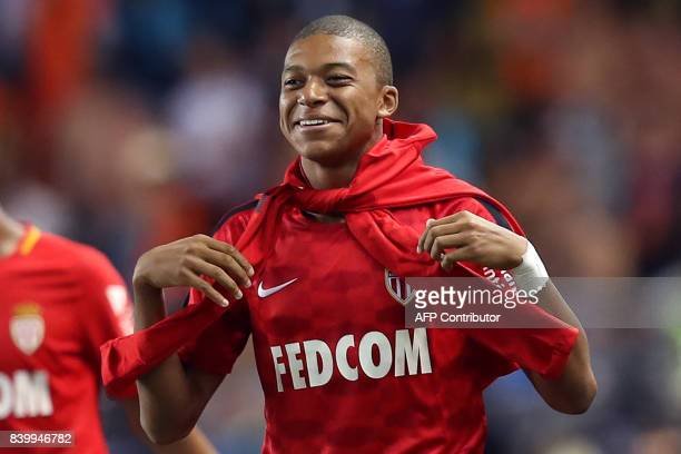 Monaco's French forward Kylian Mbappe smiles after the French L1 football match between Monaco and Marseille on August 27 at the Louis II Stadium in...