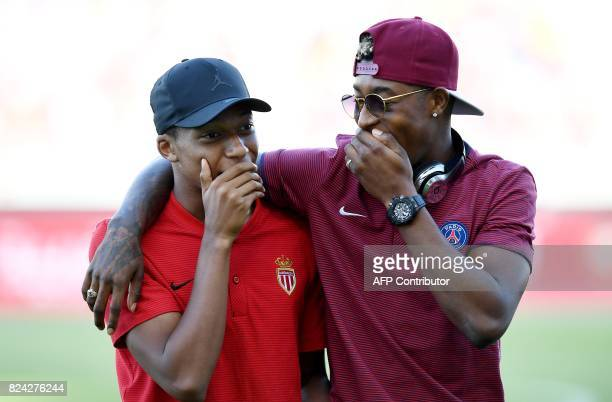 Monaco's French forward Kylian Mbappe speaks with Paris SaintGermain's French defender Presnel Kimpembe ahead of the French Trophy of Champions...