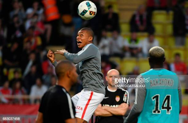 Monaco's French forward Kylian Mbappe warms up prior to the French L1 football match between AS Monaco and LOSC Lille at the Louis II Stadium in...
