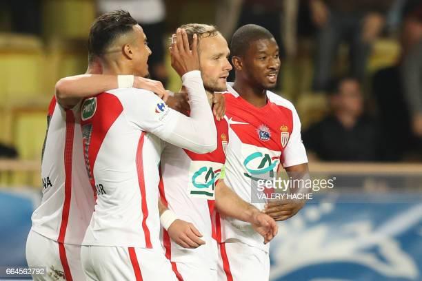 Monaco's French forward Valere Germain celebrates after scoring a goal during the French Cup football match between Monaco vs Lille at the 'Louis II'...