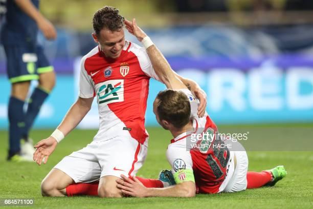 Monaco's French forward Valere Germain celebrates with his teammate French forward Irvin Cardona after scoring a goal during the French Cup football...