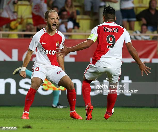 Monaco's French forward Valere Germain celebrates with Monaco's Colombian forward Radamel Falcao after scoring a goal during the Champions League...