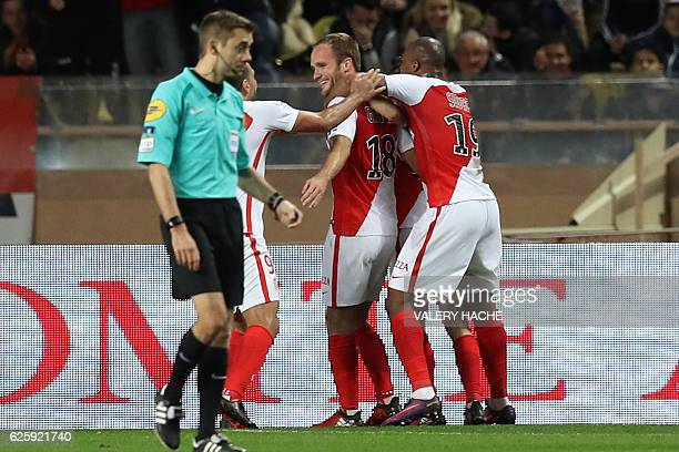 Monaco's French forward Valere Germain celebrates with teammates after scoring a goal during the French L1 football match Monaco vs Marseille on...