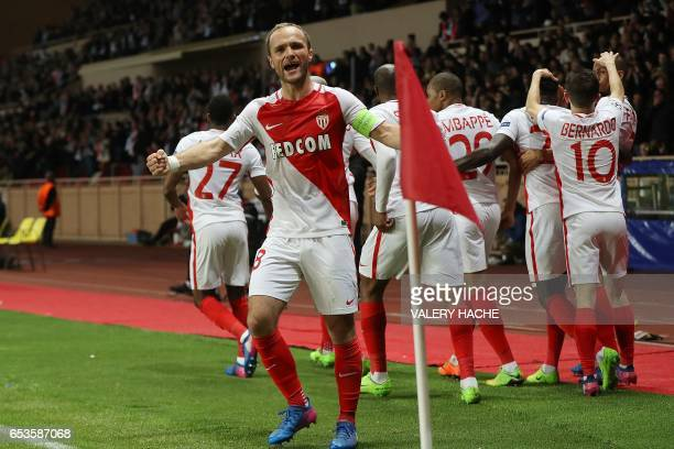 Monaco's French forward Valere Germain celebrates with teammates after their second goal during the UEFA Champions League round of 16 football match...