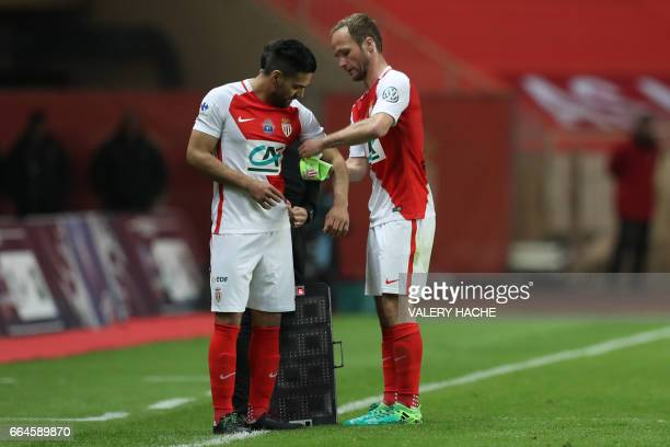 Monaco's French forward Valere Germain gives the captain's armband to Monaco's Colombian forward Radamel Falcao during the French Cup football match...