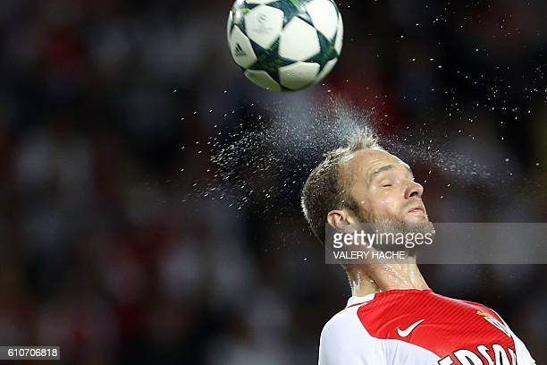 TOPSHOT Monaco's French forward Valere Germain heads the ball during the UEFA Champions League football match AS Monaco vs Bayer Leverkusen on...